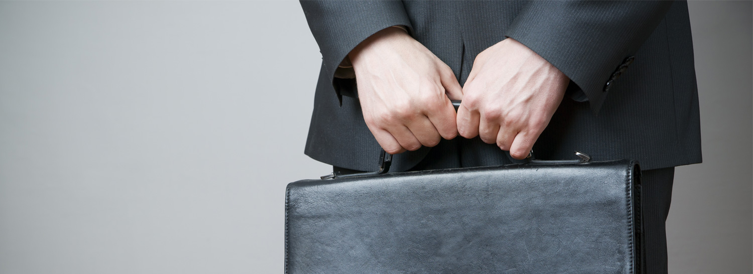 A Business man holding a briefcase.